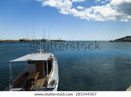 City bay with the ships in it under the blue sky and a bright sun - stock photo