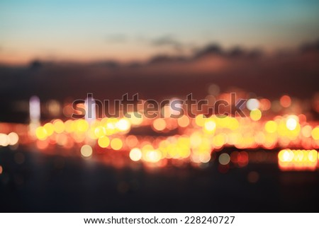 City blurring lights abstract circular bokeh background - stock photo