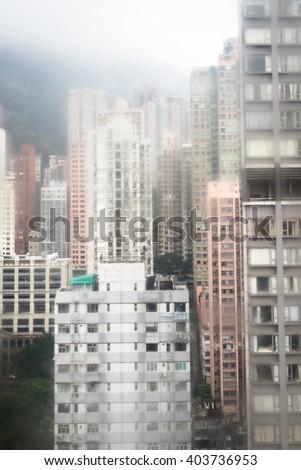 city buildings on a rainy day - stock photo