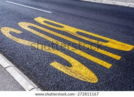 City bus transport lane sign on the asphalt road - stock photo
