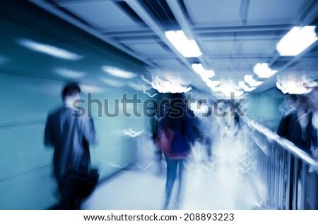city business passenger crowd walk at subway station abstract blur - stock photo
