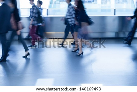 city business people walking (abstract blurred motion) - stock photo