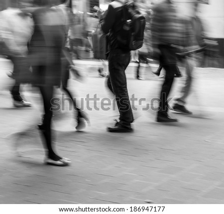City business people walking in the commercial street, black and white blur background  - stock photo