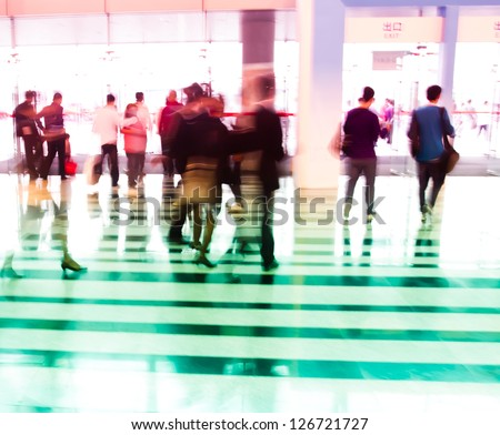 city business people walking in the lobby in intentional action blur and a colorful tint - stock photo