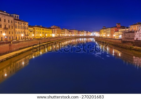 City center of Pisa with reflection in Arno river, Italy - stock photo