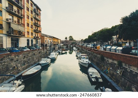 City channel with bridge and boats. Livorno, Italy - stock photo