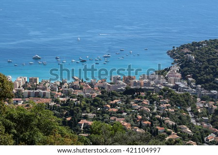 city coastline shore yachts in harbor view from mountains day time blue sea on seascape background - stock photo