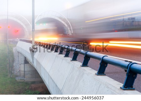 City expressway road in the morning fog, Lochkov tunnel, Prague, Czech republic - stock photo