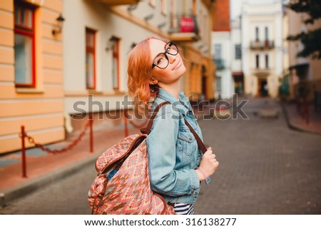 City fashion portrait of young business woman,teen student girl,wearing elegant sky blue suit, curly amazing hairs, vintage sunglasses, soft warm colors. Happy mood.student collage  - stock photo