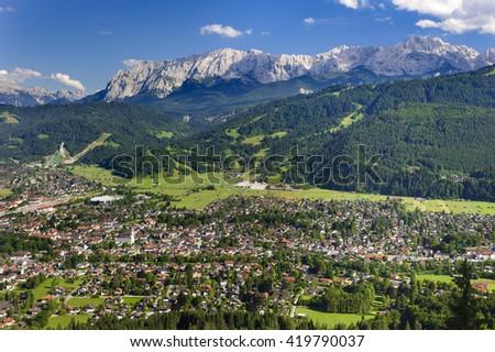 city Garmisch-Partenkirchen in Bavaria with alps mountains - stock photo