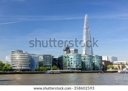 City Hall, The Shard and HMS Belfast on the River Thames. - stock photo