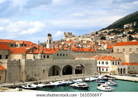 City harbor with cozy backyards in Croatia, Dubrovnik. Famous old town fortress on the Adriatic. - stock photo