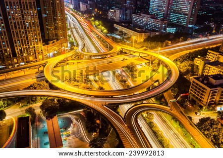 city highway interchange closeup , guangzhou huangpu overpasses at night   - stock photo