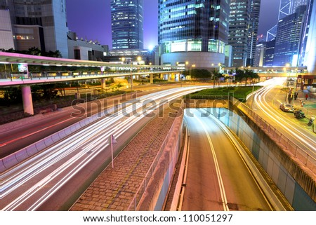 city in night with busy traffic - stock photo