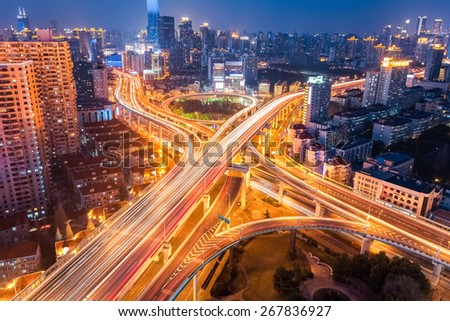 city interchange at night , overpass and viaducts in shanghai - stock photo