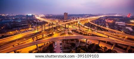city interchange closeup at night , beautiful transport infrastructure background - stock photo