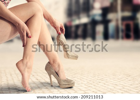 city landscape and legs  - stock photo