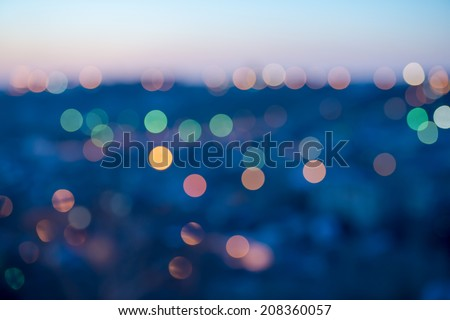city lights abstract circular bokeh on blue background - stock photo
