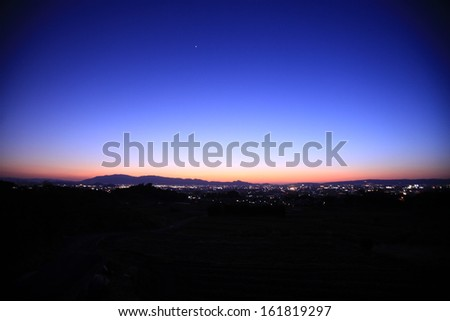 City lights at dawn and a clear sky. - stock photo