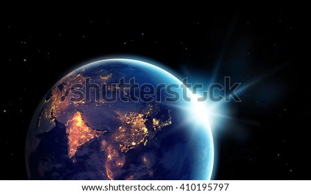 City lights at night in planet earth with with sun rising, Elements of this image furnished by NASA - stock photo