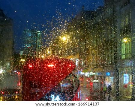 City lights from London bus in rainy night - stock photo