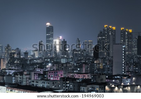 City night scene of Hong Kong with apartments and skyscrapers. - stock photo