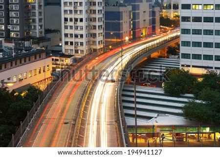 City night scene with cars motion blurred light in Hong Kong, Asia. - stock photo