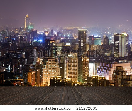City night scene with wooden ground.  - stock photo