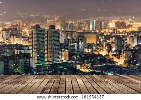 City night scene with wooden ground, Taipei, Taiwan. - stock photo