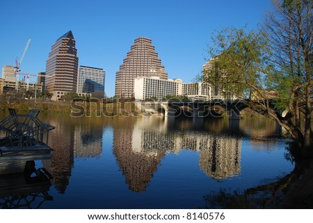 City of Austin, Texas downtown district highrise buildings reflecting on Town Lake - stock photo