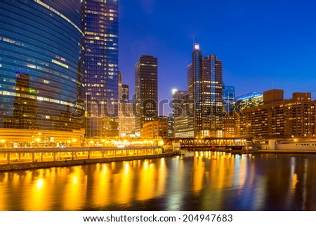 City of Chicago downtown and River with bridges at dusk. - stock photo