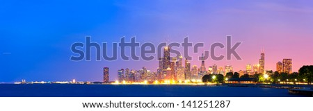 City of Chicago USA, sunset colorful panorama skyline of downtown with illuminated business buildings - stock photo