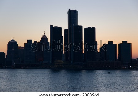 City of Detroit skyline, taken from Windsor Ontario at dusk. - stock photo