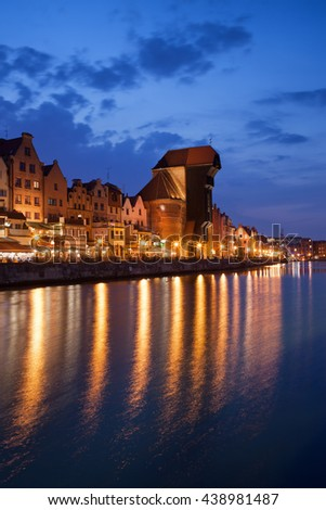 City of Gdansk in Poland by night, Old Town skyline from Motlawa River - stock photo