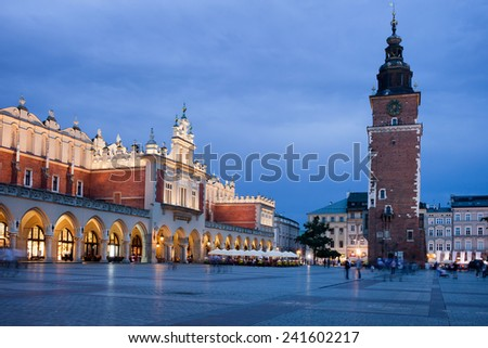 City of Krakow at night in Poland. Cloth Hall (Polish: Sukiennice) and Town Hall Tower on the Main Market Square in the Old Town. - stock photo