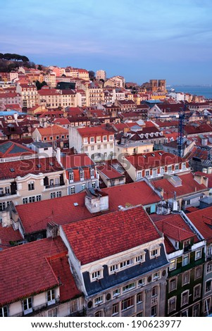 City of Lisbon at twilight in Portugal, rooftops of the Baixa and Alfama districts. - stock photo