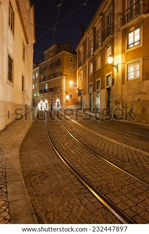 City of Lisbon in Portugal at night, Largo Santa Luzia street with tramway of the famous tram 28. - stock photo