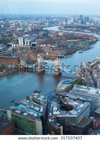 City of London panorama at sunset. River Thames, Tower bridge and Canary Wharf in the distance. Aerial view - stock photo