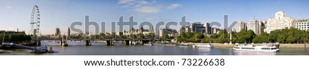 City of London Panoramic view from Waterloo Brige. London eye, Big Ben and Houses of Parliament. - stock photo