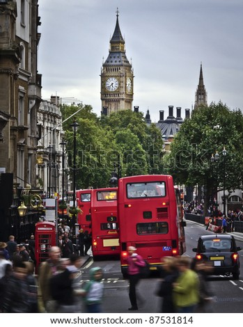 City of  London, View from Trafalgar Square: Big Ben, double deckers, red phonebox, taxi cab, people. - stock photo