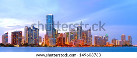 City of Miami Florida, colorful sunset panorama of downtown business and residential buildings - stock photo