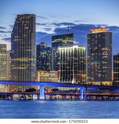 CIty of Miami Florida, illuminated business and residential buildings and bridge on Biscayne Bay  - stock photo
