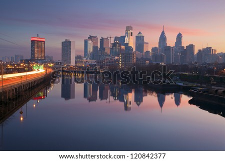 City of Philadelphia. Image of Philadelphia skyline in a morning mist, Schuylkill River and busy highway leading in to the city during sunrise. - stock photo