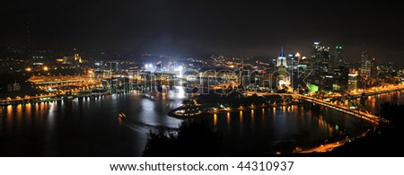 City of Pittsburgh at night with stadium lights on - stock photo