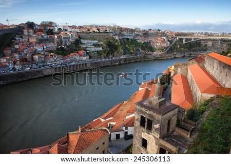 City of Porto in Portugal, on the first plan wine cellar rooftops of Vila Nova de Gaia. - stock photo