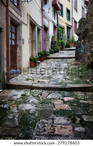 City of Porto in Portugal, sloping, narrow, medieval alley with traditional houses in the Old Town. - stock photo
