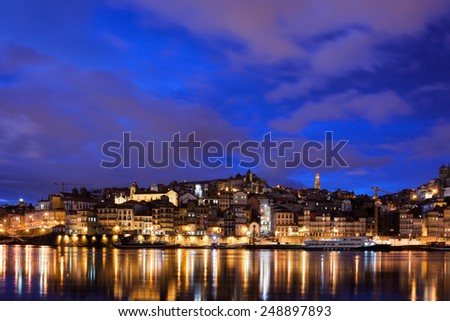 City of Porto skyline at night with reflection on river Douro in Portugal. - stock photo