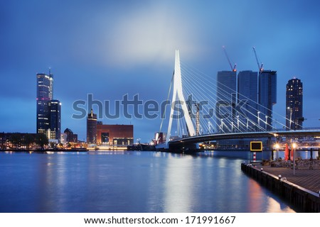 City of Rotterdam downtown skyline by the river at night in South Holland, the Netherlands. - stock photo