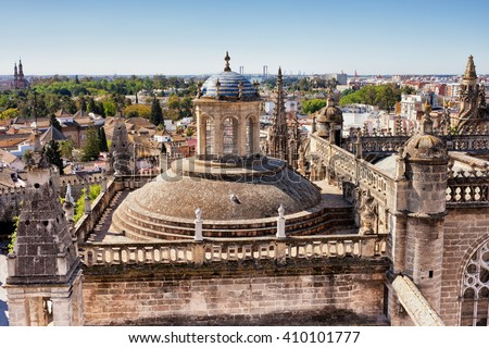 City of Seville in Andalusia, Spain, Gothic architecture of Sevilla Cathedral, rooftop, dome and finials, cityscape - stock photo