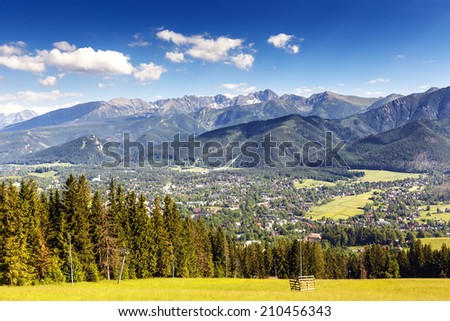 City of Zakopane and Tatras seen from the top of Gubalowka, emphasize the beauty of the Polish Podhale - stock photo